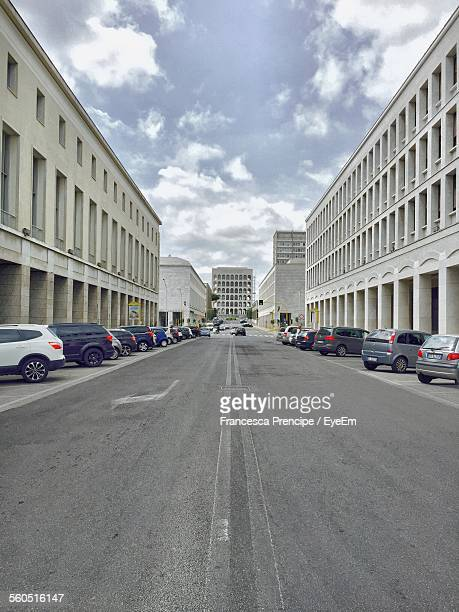 road between buildings at eur - eur rome stock pictures, royalty-free photos & images