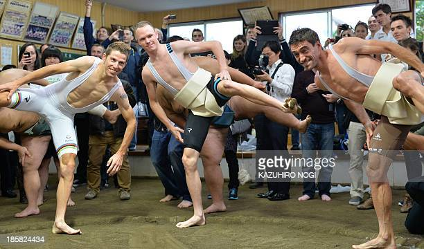 Road bicycle racers Rui Costa of Portugal Christopher Froome of Britain Christophe Riblon of France participate in sumo training as part of an...