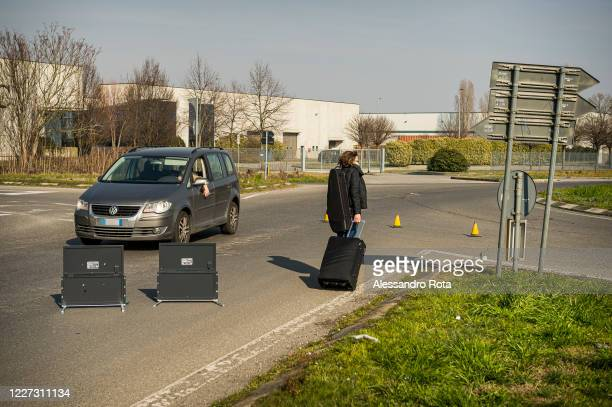 Road block outside of Codogno is manned by police on February 24,2020 in Codogno,Italy. The country is facing the biggest outbreak of corona virus in...