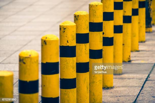 Road block pole in straight line