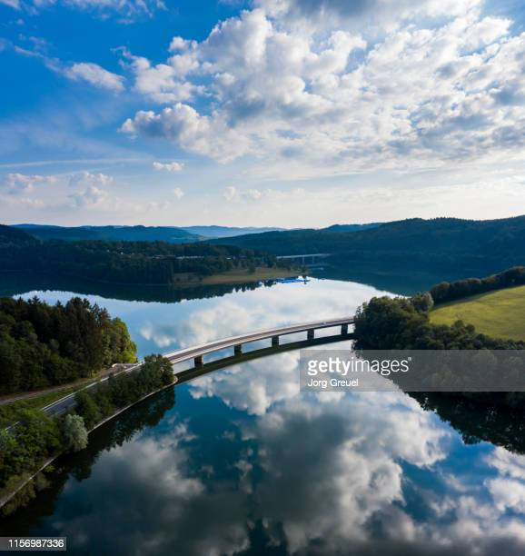 road bridge across reservoir - reservoir stock pictures, royalty-free photos & images