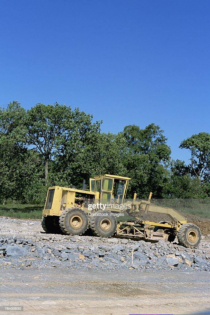 Road building grader at construction site : Stockfoto