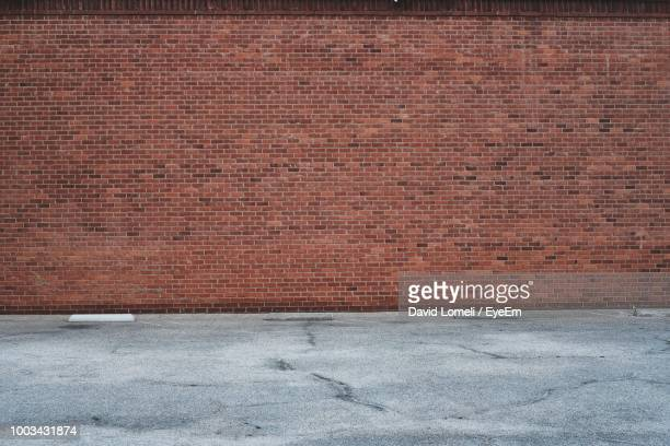 road by brick wall - brick stock pictures, royalty-free photos & images