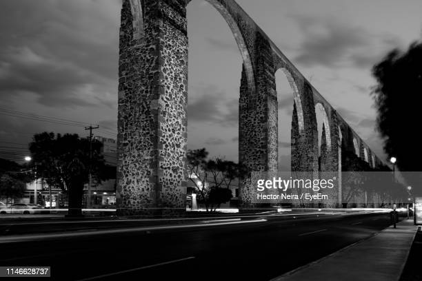 road by bridge in city against sky - mexico black and white stock pictures, royalty-free photos & images