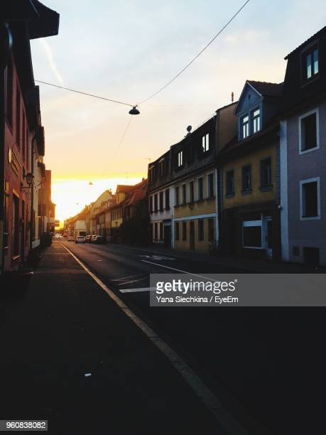 road by buildings against sky during sunset - erlangen stock photos and pictures