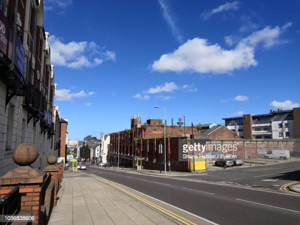 road by buildings in city against sky - merseyside stock pictures, royalty-free photos & images