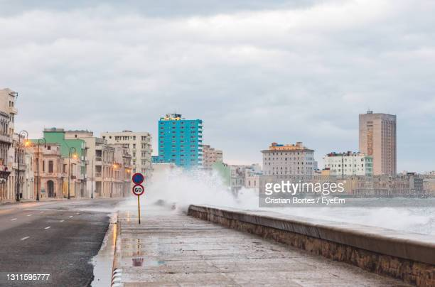 road by buildings in city during rainy season - bortes stock pictures, royalty-free photos & images