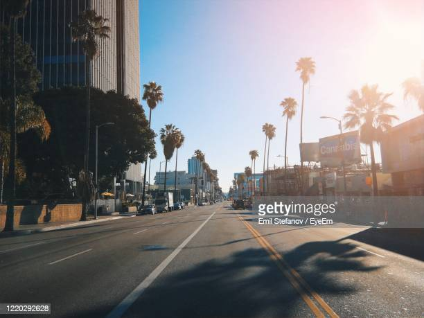 road by buildings in city of los angeles, usa against sky - city of los angeles stock pictures, royalty-free photos & images