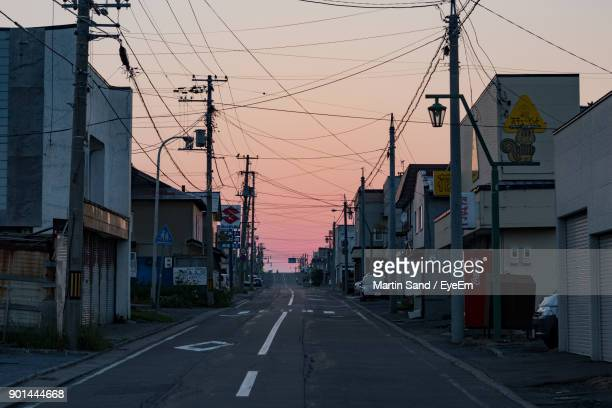 road by city against clear sky - 町 ストックフォトと画像