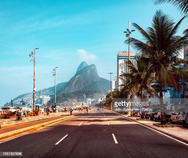 road by city against sky - brazil stock pictures, royalty-free photos & images