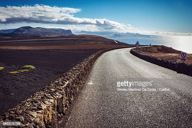 Road By Field At Canary Islands Against Sky