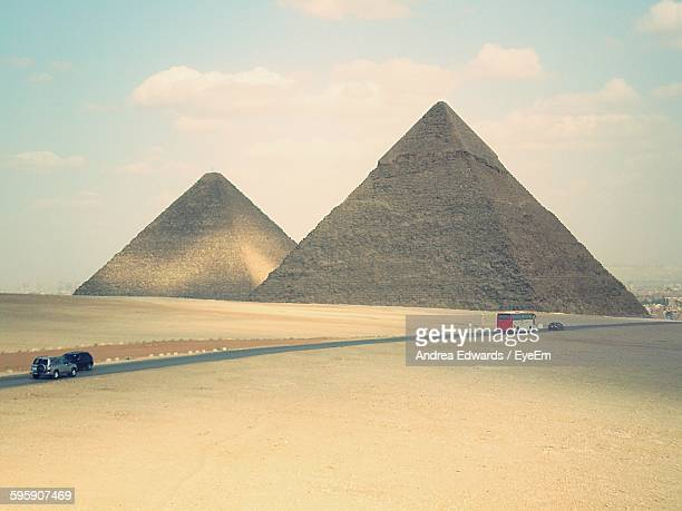 Road By Great Pyramid Of Giza Against Cloudy Sky