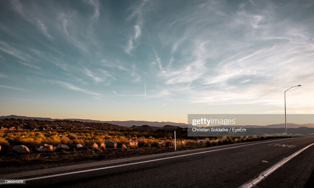 Road By Landscape Against Sky : Stock-Foto