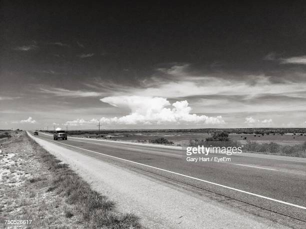 road by landscape against sky - roswell stock pictures, royalty-free photos & images