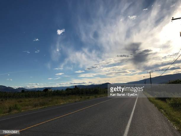 road by landscape against sky - kelowna stock pictures, royalty-free photos & images