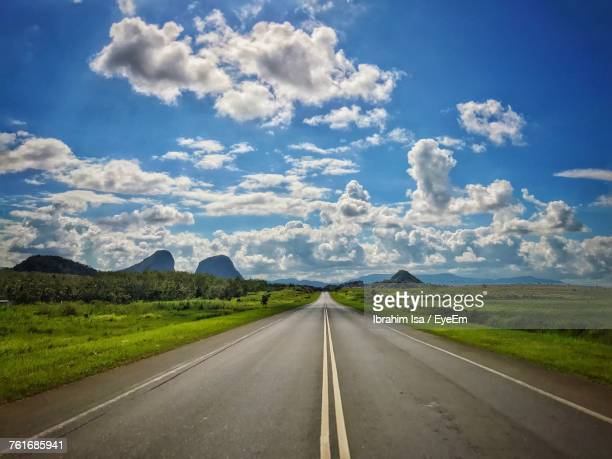 Road By Landscape Against Sky
