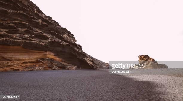 road by mountain against clear sky - bortes photos et images de collection