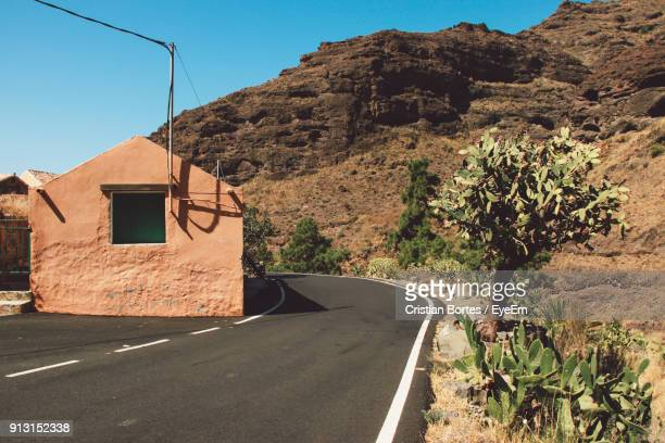 road by mountain against clear sky - bortes cristian stock photos and pictures