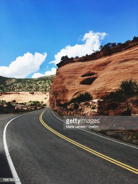 road by mountain against sky - fruita colorado stock pictures, royalty-free photos & images
