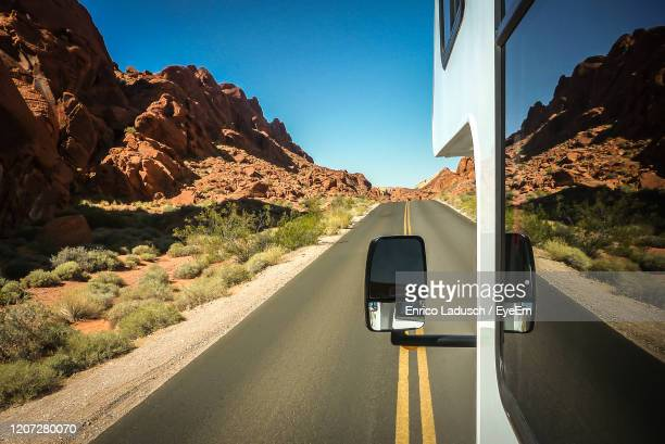 road by mountains against clear sky - camper van stock pictures, royalty-free photos & images