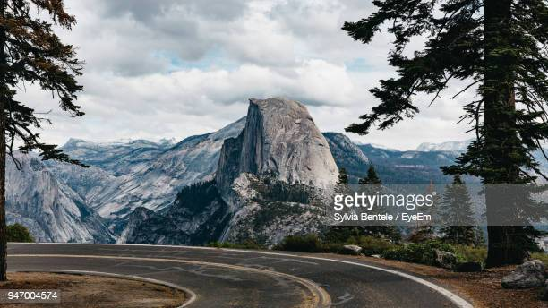 road by mountains against sky - yosemite national park stock pictures, royalty-free photos & images