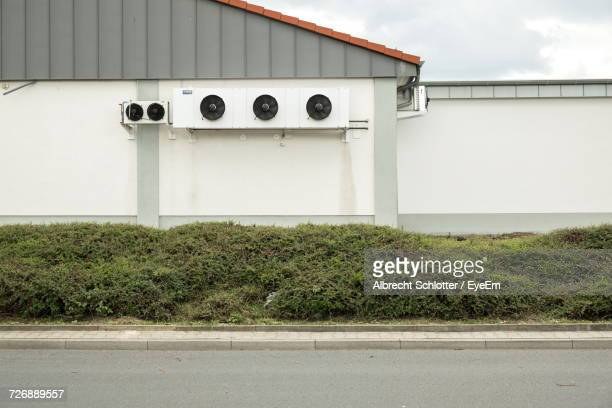 road by plants against building - albrecht schlotter stock photos and pictures