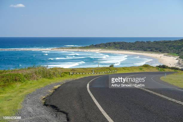 road by sea against clear sky - new south wales stock pictures, royalty-free photos & images