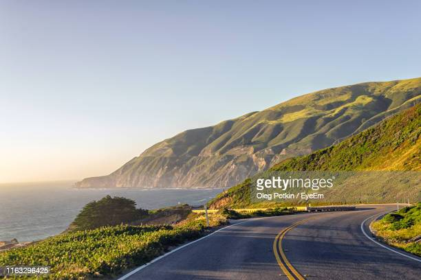road by sea against clear sky - monterrey stock pictures, royalty-free photos & images