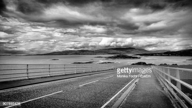 Road By Sea Against Dramatic Sky