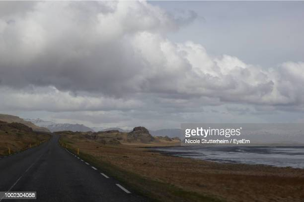 road by sea against sky - stutterheim stock pictures, royalty-free photos & images