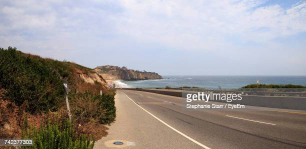 road by sea against sky - laguna beach california stock pictures, royalty-free photos & images