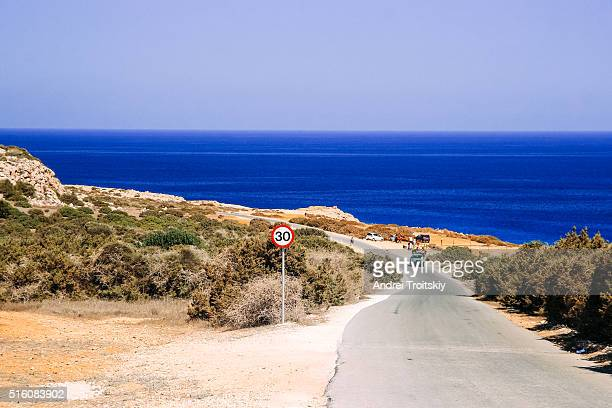 Road by the sea shore on beautiful summer day near Cape Greko, Cyprus