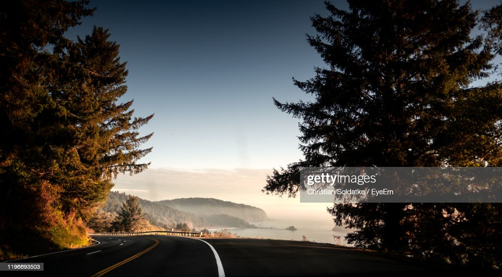 Road By Trees Against Sky During Sunset : Stock-Foto
