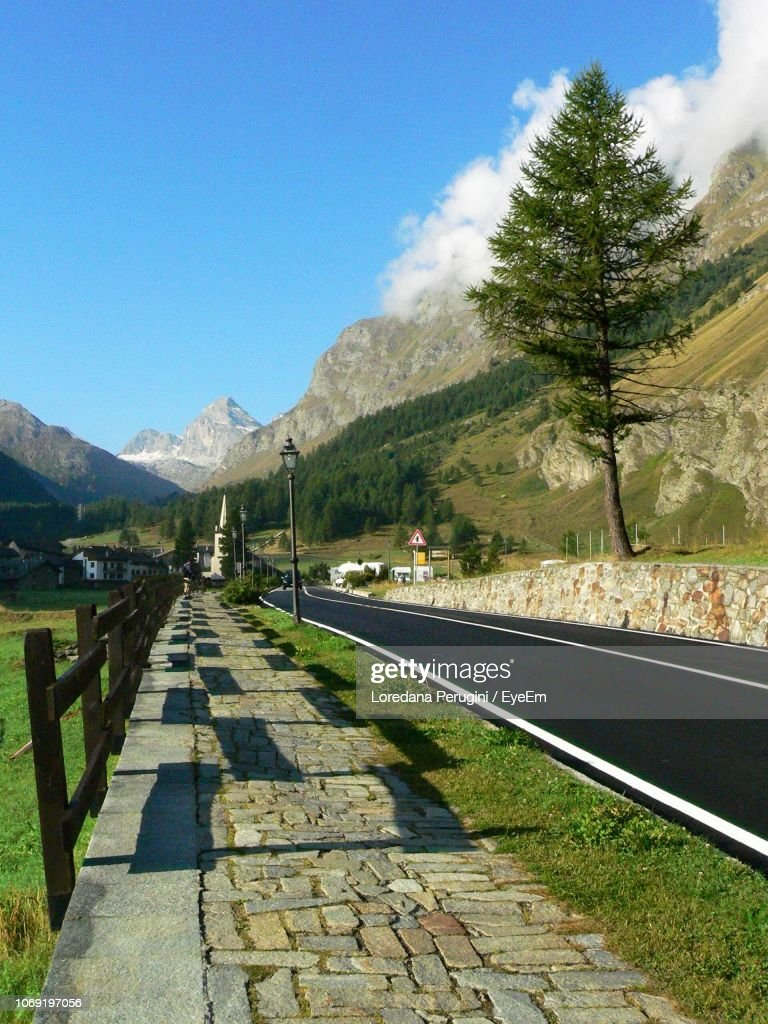 Road By Trees Against Sky : Foto stock
