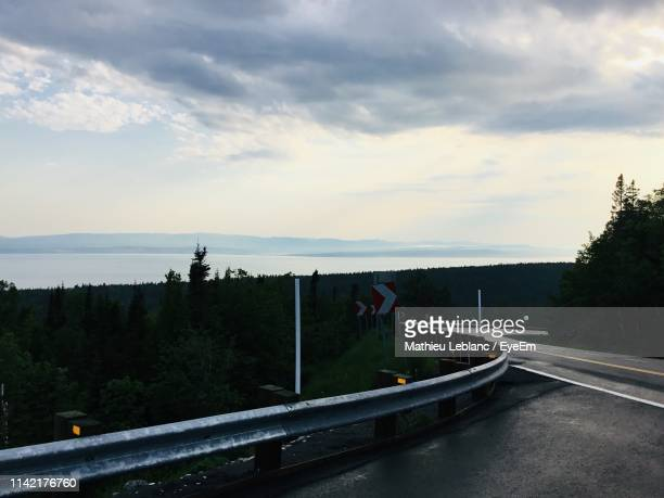 road by trees against sky - cap des rosiers stock pictures, royalty-free photos & images