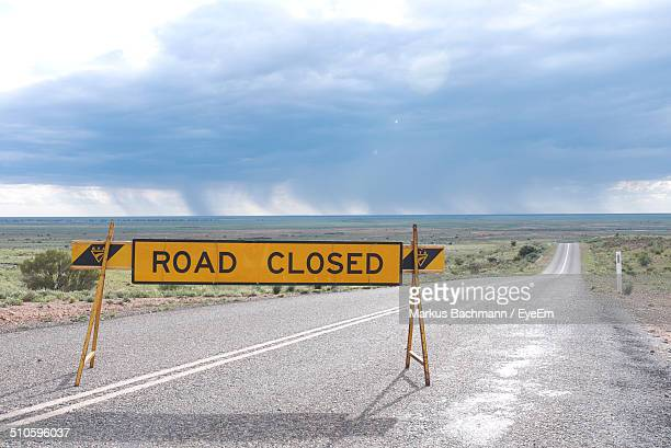 Road closed sign along countryside landscape