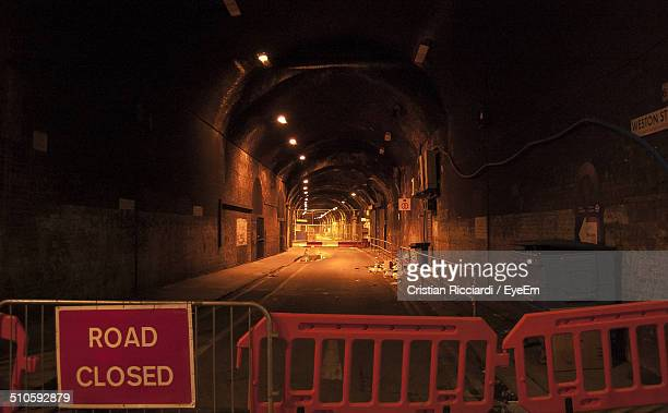 Road closed sign in arched tunnel