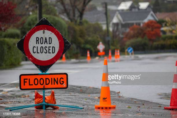 Road closed sign next to floodwater in Christchurch, NewZealand on May 30, 2021.MetService has put in place code red severe weather warning for the...