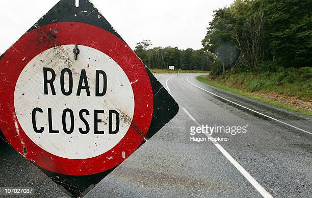 A 'road closed' sign prevents traffic from using the road leading up to the Pike River Coal underground mine on November 20 2010 in Greymouth New...