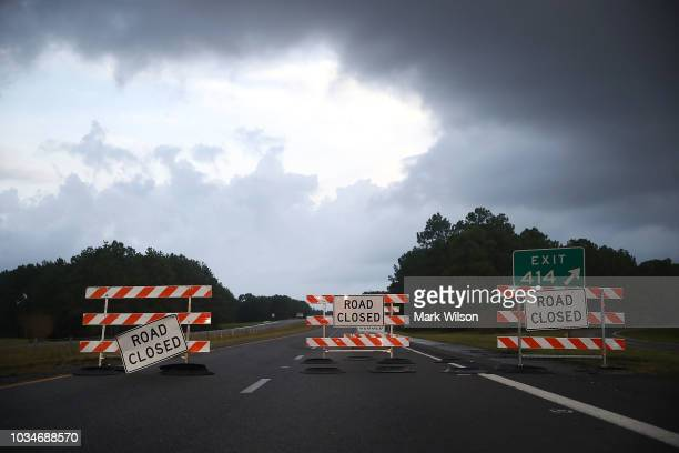 Road closed signs sit on Rt40 due to flooding on September 17 2018 in Wilmington North Carolina Hurricane Florence hit Wilmington as a category 1...