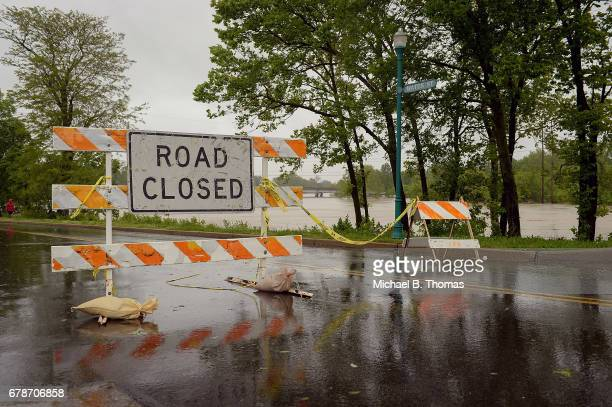 A road closure sign is placed along the banks of the Meramec River on May 4 2017 in Fenton Missouri Towns along the Meramec River brace for the river...