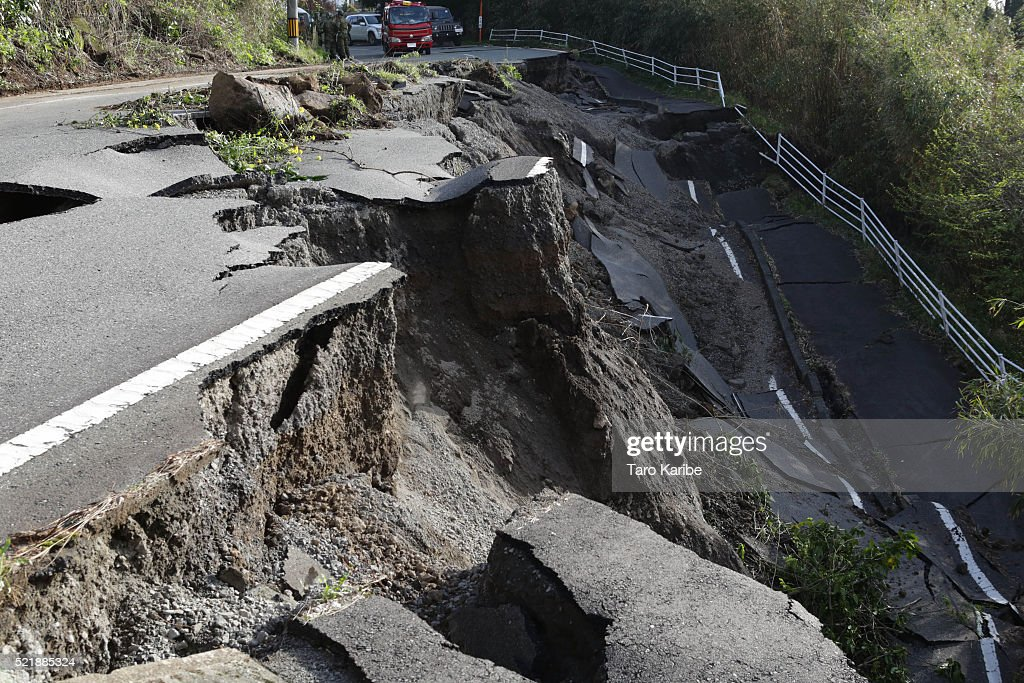 A road collapse and landslide are seen on April 17, 2016 in Kumamoto, Japan. A magnitude-7.3 earthquake hit Kumamoto prefecture on Japan's Kyushu Island on Saturday after one measuring 6.4 struck on Thursday. As of Sunday, reports indicate that 42 people have been killed, 1,500 were injured, and 11 people remain missing. An estimated 80,000 homes are without power and 400,000 homes have no running water.