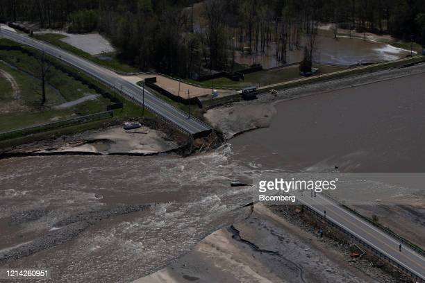 A road collapsed due to flood water is seen in this aerial photorgraph taken after dams failed in Midland Michigan US on Wednesday May 20 2020...