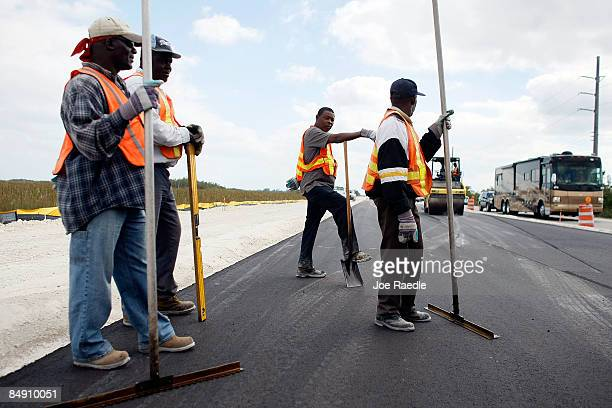 Road construction crews contracted by Parsons Brinckerhoff work on a widening project run by the Florida Department of Transportation on February 18...