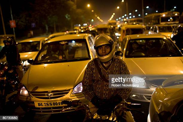Road construction in New Delhi India has not kept pace with economic development and booming car sales February 2 2008 in New Delhi India It's...