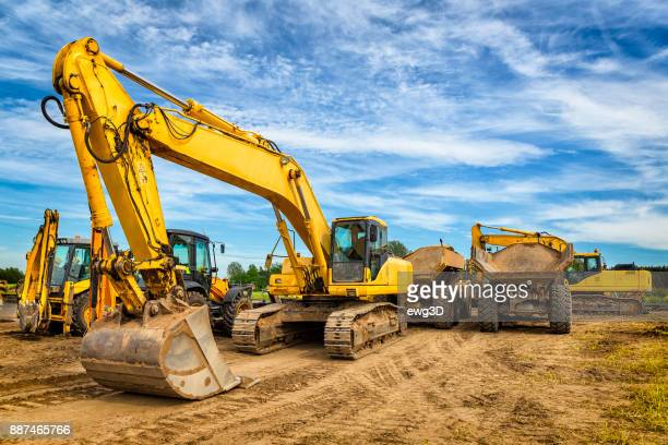 road construction machinery on the construction of highway - construction site stock pictures, royalty-free photos & images