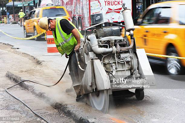 road construction machinery operator - asphalt paving stock photos and pictures
