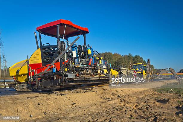 road construction machinery - asphalt paving stock photos and pictures