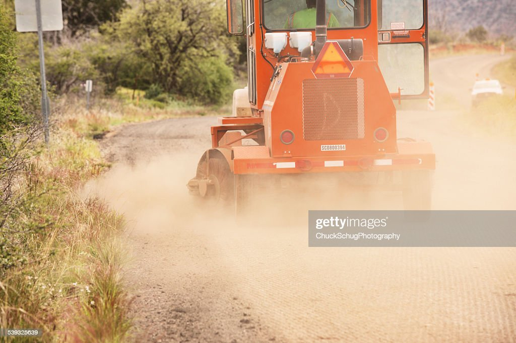 Road Construction Machinery Sweeping Dust : Stock Photo