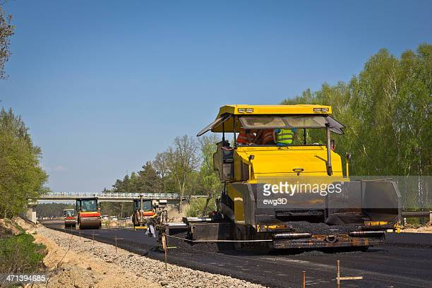 Road construction machines at work